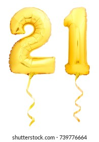 Golden number 21 twenty one made of inflatable balloon with golden ribbon isolated on white background