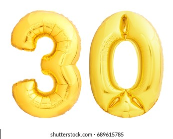 Golden number 30 thirty made of inflatable balloon isolated on white background