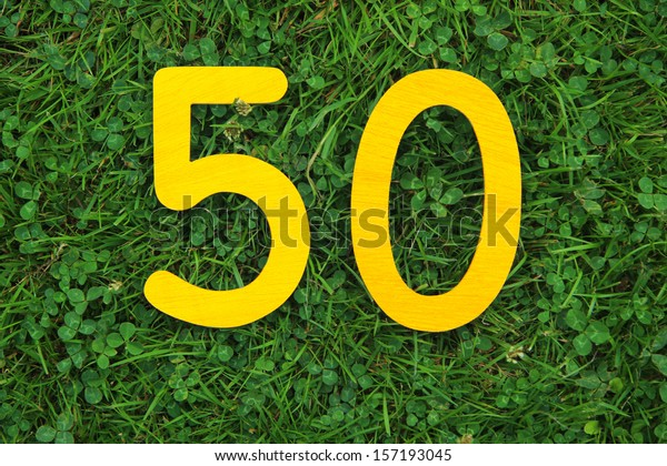golden number 50 on grass