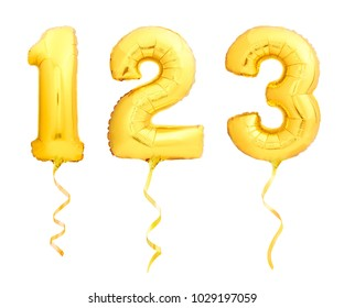 Golden numbers 1, 2, 3 made of inflatable balloons with golden ribbons isolated on white background
