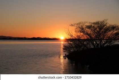 Golden orange sunset over the Sacramento River, California