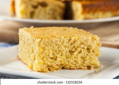 Golden Organic Homemade Cornbread cut into squares