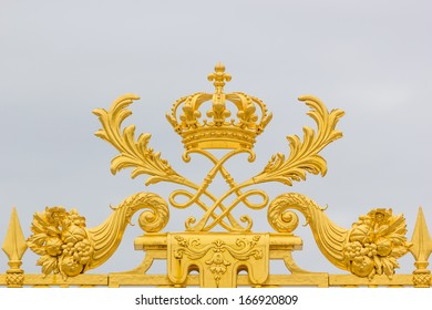 Golden ornate gate of Chateau de Versailles Paris, France, Europe.
