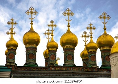 Golden Orthodox crosses and domes of the Church of the Nativity (Verkhospasskiy Sobor) at Kremlin, Moscow with blue sky
