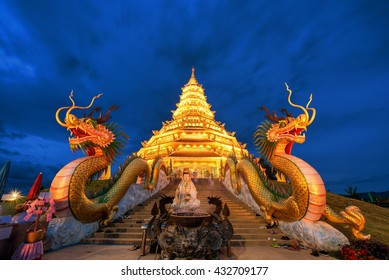 Golden Pagoda nine tier with dragon texture at Chinese temple - wat hyua pla kang temple , Chiang Rai,northern of Thailand , most beautiful popular temple in Thailand