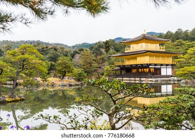 Golden pagoda on lake and tree background in autumn at Kinkakuji Temple, Kyoto, Japan.