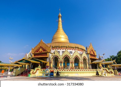 Golden pagoda and temple , Kaba aye Pagoda (Yangon, Myanmar) with clear blue sky