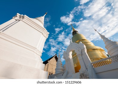The golden pagoda at Wat Suan Dok, Chiangmai, Thailand. The beautiful pagoda in contrasted with beautiful blue sky and clouds.