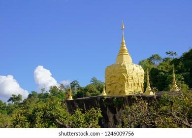Golden Pagoda at Wat Tham Pha Dan on Phu Pan Mountain Range, Sakon Nakhon Province, Thailand