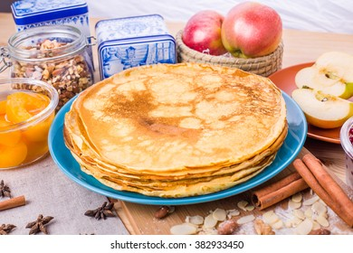 Golden pancakes on a blue plate. Traditional Russian dish on Shrove Tuesday