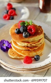 Golden pancakes with summer berry and honey, food closeup