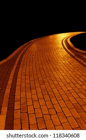 Golden pavement road isolated on black background