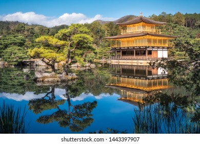 Golden Pavilion or Kinkaku-ji and it's amazing surrounding Japanese gardens, early in the morning, reflected in the pond's water, in Kyoto, Japan.