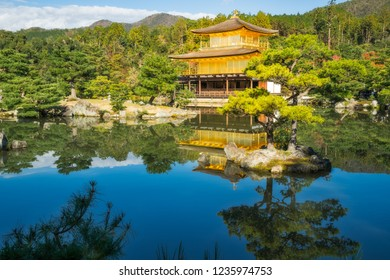 The Golden Pavilion or Kinkaku-ji Temple and the beautiful surounding Japanese Garden, in the morning with reflections in the water, Kyoto, Japan