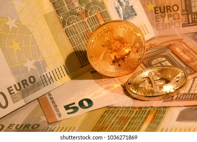 Golden phisical bitcoin with Euro banknotes. Bitcoin cryptocurrency.
