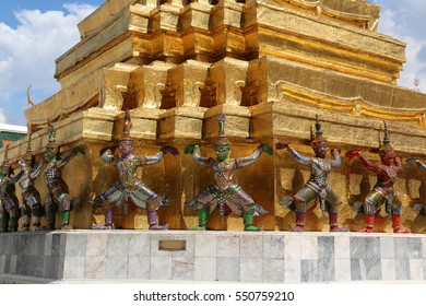 Golden Phra Chedi decorated with giants who appear to be lifting the chedi at Emerald Buddha Temple in Bangkok, Thailand, was constructed by King Rama 1 in honor of his parent.