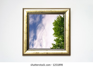 golden picture frame with landscape shot on white wall, landscape photo is mine