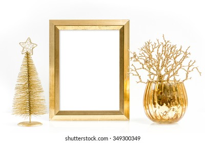 Golden picture frame and shiny christmas ornaments. Festive decoration