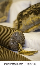 golden pillows on a classic styled bed