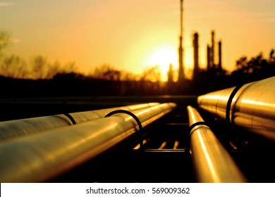 Golden pipes going to crude oil refinery
