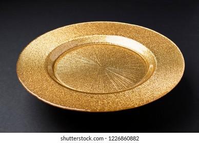 Golden plate on a dark background.