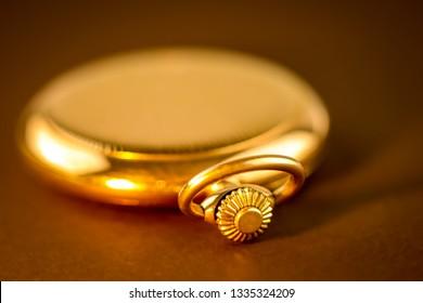 golden pocket watch detail closeup