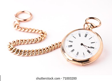 golden pocket watch isolated against a white background