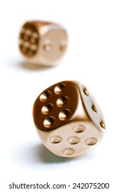 Golden poker dices isolated on white background with clipping path