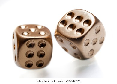 Golden poker dices isolated on white background