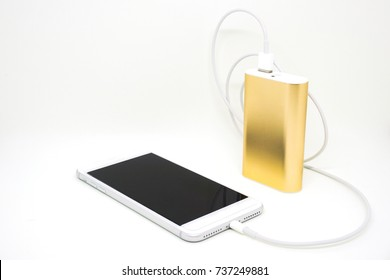 Golden Power Bank Give Charge to Smartphone Through USB Cable on White Background with Copy Space