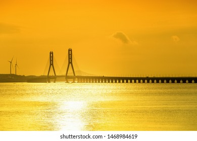 golden poyang lake and cable-stayed bridge bathed in the sunlight, jiangxi province, China