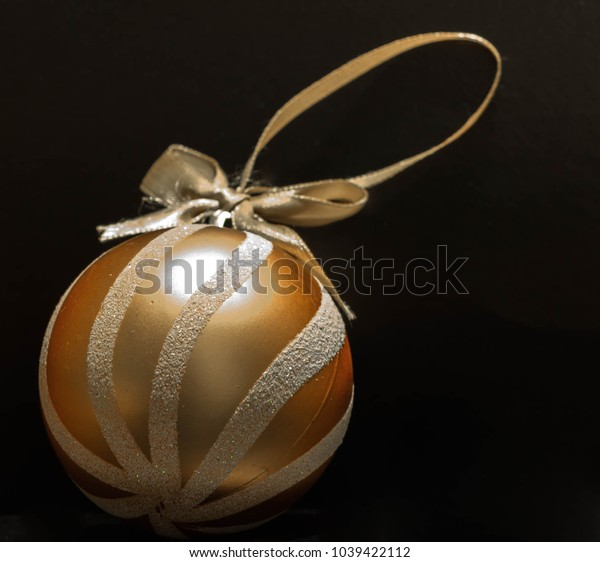 Golden print holiday ball - Christmas toy for the Christmas tree.
