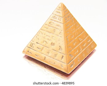 Golden pyramid isolated on a white background