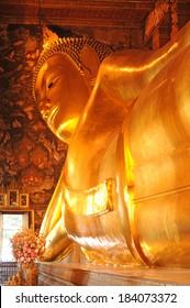 Golden Reclining Buddha statue. Wat Pho, Bangkok, Thailand