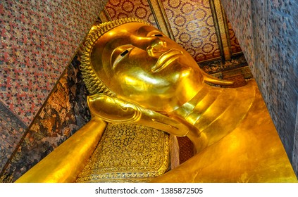 Golden reclining Buddha in Wat Pho Temple in the city of Bangkok in Thailand