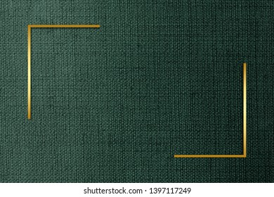 Golden rectangle on a green fabric textured background