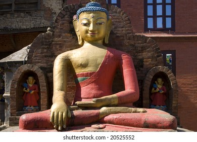 A golden and red large Buddha statue in Kathmandu, Nepal