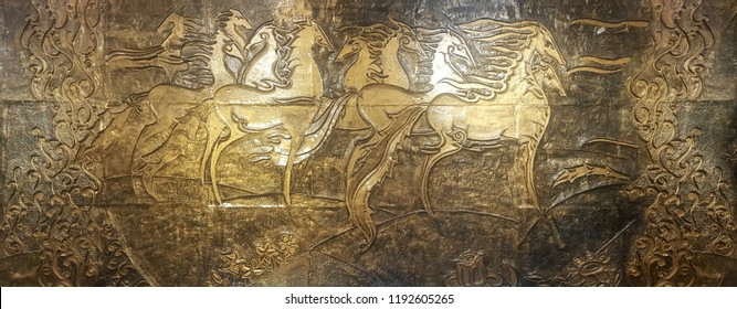 Golden relief wall with horses