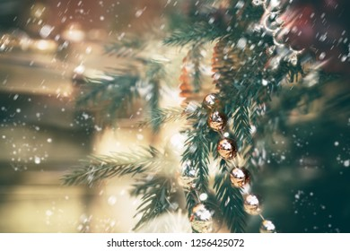 Golden retro baubles hanging on fir branches