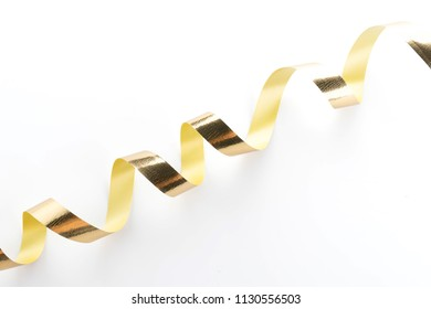 Golden ribbon roll isolated on white background
