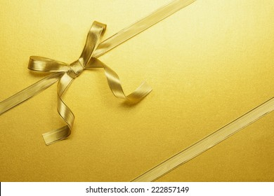 golden ribbon tied in a bow