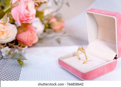 Golden ring with diamonds in jewelry box decorate with flower. Concept Wedding , Love , Valentine's day, Happy Birthday.