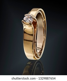 Golden ring with gemstone isolated on black background. with clipping path