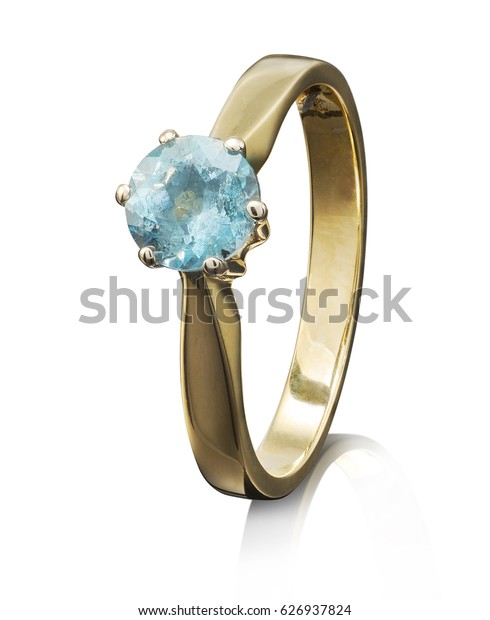 Golden ring with gemstone isolated on white background.