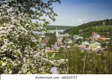 Golden Ring of Russia. View of the small ancient town Plyos from Volga river. Orthodox church with domes on top of a hill in a Russian village, standing on the banks of the Volga River.