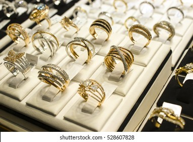 Golden rings with diamonds and other gemstones jewelry for women in the gold market.