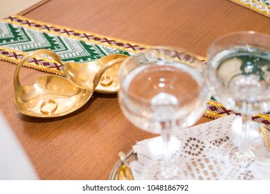 Golden rings and goblets prepared for newly weds at register office