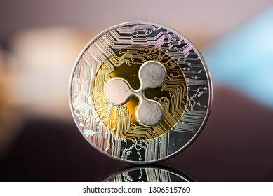 Golden ripple coin. Crypto XRP Coin  on dark background. Close-up, macro shot.New Virtual Money