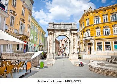 Golden Roman Gate (Sergius Arch) in Pula at sunhy day, Croatia