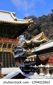 Golden roof of Yomeimon Gate and the Bell tower of Toshogu Shrine in Nikko, Tochigi, Japan, in a winter day with newly fallen snow. National Treasures of Japan. Toshogu is dedicated to Tokugawa Ieyasu